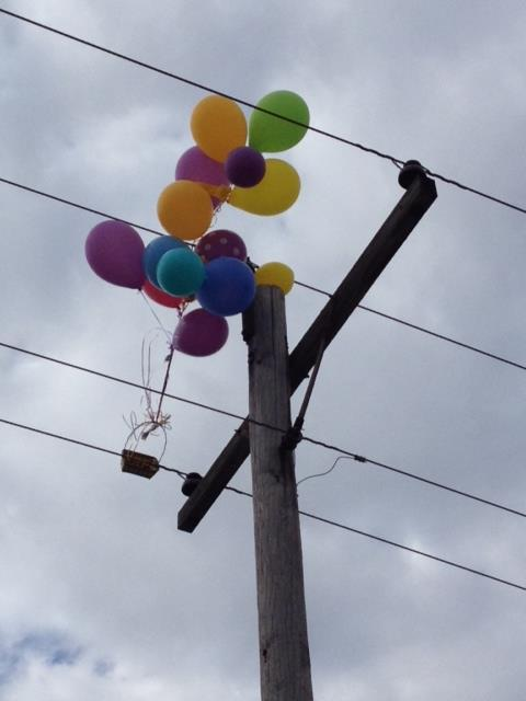 balloons caught in power pole line